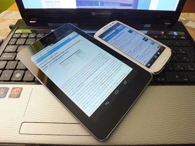 Smartphone and tablet on laptop